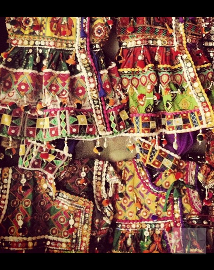 A stall selling traditional Gujrati clothes at Law Garden evening market.
